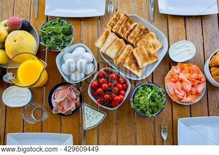 Food On The Table Top View. Breakfast On The Terrace With The Family.friends Are Eating At The Table