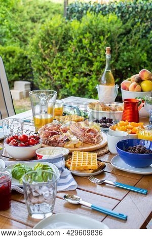 Laid Table With Food.breakfast On The Terrace.a Table With Food For A Large Family.a Party.banquet.d