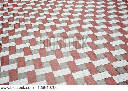 Concrete Or Paved Newly Laid Gray And Red Paving Slabs Or Stones For Floors Or Walkways. Concrete Pa
