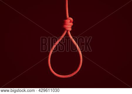 Red Braided Hanging Noose Tied Knot. Hanging Suicide, Death Penalty Concept. Red Hangman Knot, Red B
