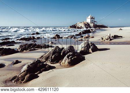 View of the Miramar Beach and chapel Senhor da Pedra, Porto, Portugal.