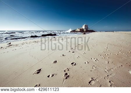 View of the Miramar Beach and chapel Senhor da Pedra, Portugal.