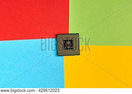 Papers In Colors Of Famous Computer Corporation, Software Manufacturer Logo. High Cpu Usage. Red, Gr