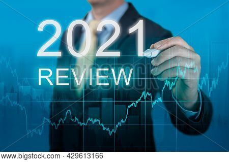 Businessman Writes 2021 Review Words. Last Year Review In Business. Economic Indicators, Overcoming