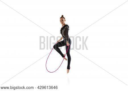 One Caucasian Girl, Rhythmic Gymnastics Artist Isolated On White Studio Background. Concept Of Sport
