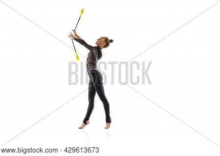 One Caucasian Girl, Rhythmic Gymnastics Artist Practicing With Baton Isolated On White Studio Backgr