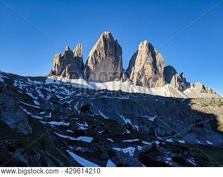 Tre Cime Di Lavaredo, View Of The Large North Face With The Morning Sun. Three Peaks In The Dolomite