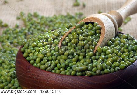 Mung Beans In A Wooden Scoop On A Table. Close Up