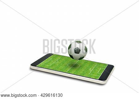 Soccer Ball Floating On Green Soccer Field Isolated On White Background. (clipping Path)