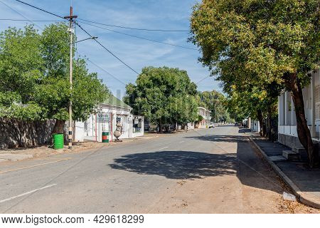 Richmond, South Africa - April 2, 2021: A Street Scene, With The Vetmuis Plaaskombuis Restaurant, In