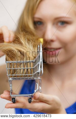 Girl With Her Long Blonde Hair In Shopping Cart. Haircut Haircare And Shopping Concept