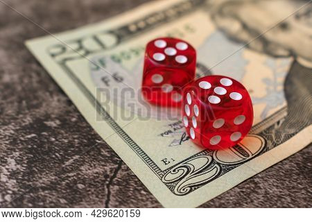 Gambling Dice For Money In A Casino. Red Dice Are On A Twenty Dollar Bill. Underground And Illegal G