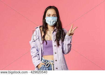 Covid19, Quarantine, People Concept. Optimistic, Smiling Happy Girl In Medical Face Mask, Inside Hom