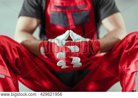 Professional Contractor Worker In A Red Uniform And Safety Gloves Awaiting Next Tough Job Concept Ph