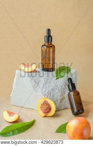 Natural Peach Oil. Natural Cosmetics, Hair Care. Bottle With Essential Peach Oil And Fresh Peaches O