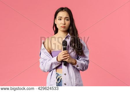 Portrait Of Gloomy And Silly Cute Asian Girl Perform Sad Song In Front Audience, Singing Karaoke, Po