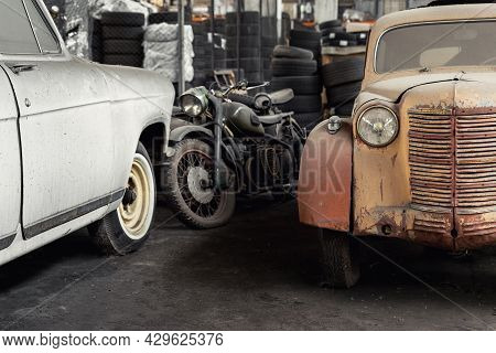 Many Rusty Abandoned Forgotten Antique Oldtimer Old Car And Motorcycles At Junkyard Factory Storage