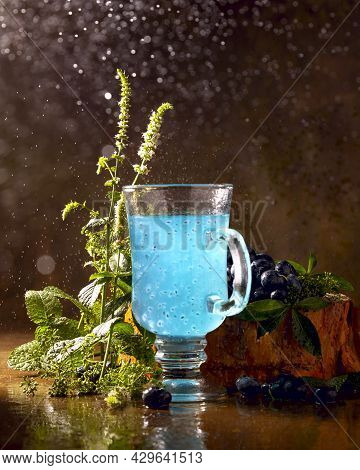 Refreshing Blue Drink With Baslic Grains And Blooming Fresh Mint
