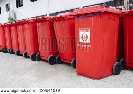 Rows Of Many Red Hazardous Waste Bins Were Arranged Neatly Outside The Field Hospital For Hygienic D