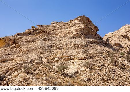 Dry, Arid Limestone Mountains In The Valley Of The Caves In Mleiha Archaeological Centre In Sharjah,