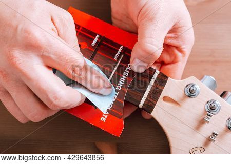 Guitar Master Polishing Frets Of Electric Guitar With Template, Top View