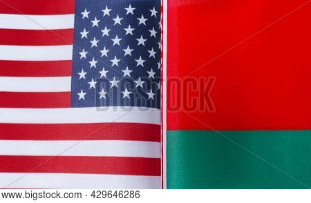Fragments Of The National Flags Of The United States And Belarus In Close-up