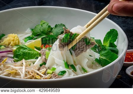 Soup Pho Bo With Beef And Spices Close Up