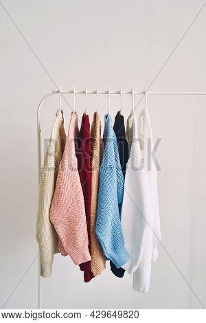 Multicolored Womens Woolen Sweaters On Hangers. Sale In A Fashion Store