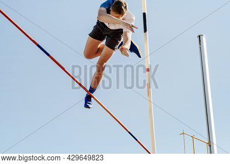 Pole Vault Male Jumper On Blue Sky Background