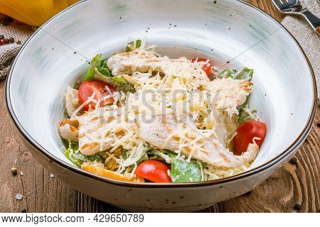 Salad Caesar With Chicken And Tomatoes On Bowl