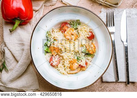 Salad Caesar With Shrimps On Bowl Top View