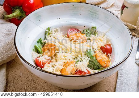 Salad Caesar With Shrimps And Tomatoes On Plate