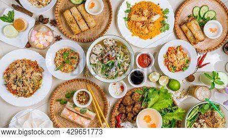 Assorted Asian Dinner, Vietnamese Food. Pho Ga, Pho Bo, Noodles, Spring Rolls Top View