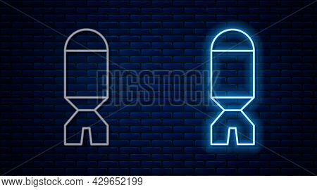 Glowing Neon Line Rocket Launcher With Missile Icon Isolated On Brick Wall Background. Vector