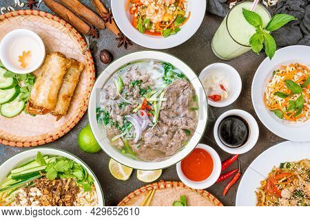 Soup Pho Bo, Spring Rolls, Salad With Shrimp, Avocado Shake, Sauces Top View