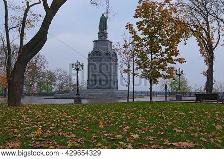 Low Angle View Of Majestic Autumn Colored Volodymyr Hill (vladimirskaya Girka). Fallen Orange Leaves