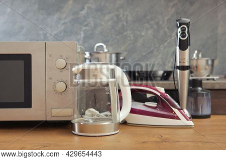 Modern Kitchen And Home Appliances On The Background Of The Kitchen Interior