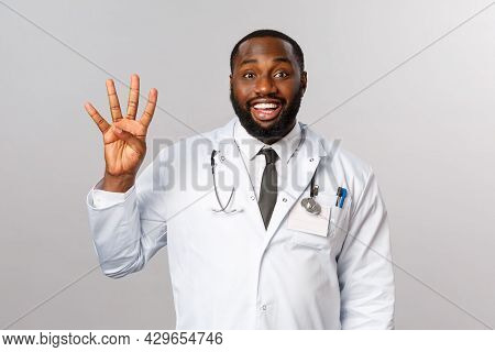 Waist-up Portrait Of Happy, Enthusiastic African-american Doctor, Hospital Physician Smiling Pleased