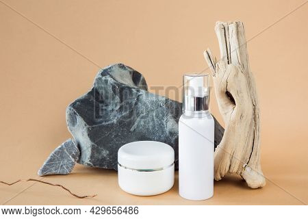 Untitled White Cosmetic Containers On A Background Of A Stone And A Wooden Branch. The Concept Of En