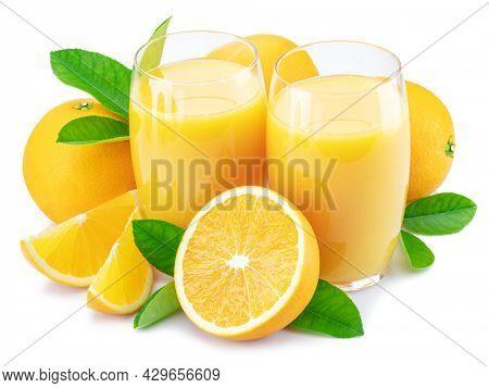 Yellow orange fruits and two glasses of fresh orange juice isolated on white background.