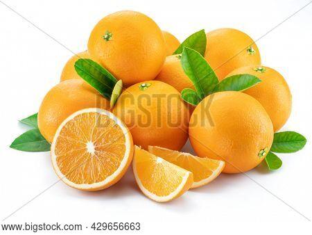 Group of fresh orange fruits and orange slices isolated on white background.