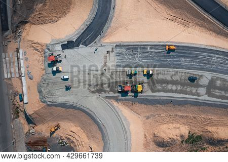 Road Construction Of Large Expressway: Road Construction Equipment Works On Laying Asphalt At Road J