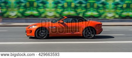 Jaguar F-type Convertible V8 550 Supercharged Awd On The Highway. Orange Premium Sports Car In Motio