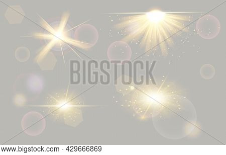 Set Of Shining Spotlights On Transparent Background. Glowing Light Effect With Gold Rays And Beams.