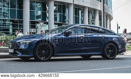 Moscow, Russia - July 2021: Glossy Blue Mercedes-benz Amg Gt 4-door Coupe Stands On Parking Slot. Fr