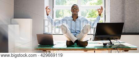 African Employee Doing Mental Health Yoga Meditation In Office