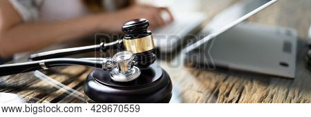 Doctor Malpractice Court. Law Gavel And Stethoscope In Courtroom