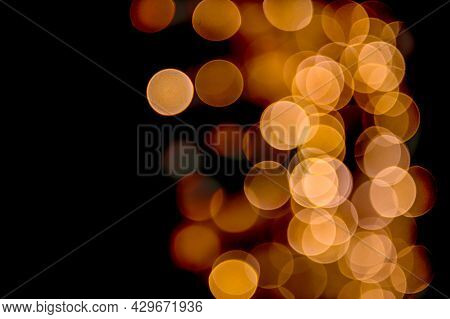 Warm Light Abstract Bokeh Made From Christmas Lights On Black Isolated Background. Holiday Concept,