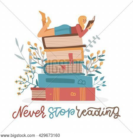 Girl Lies On Pile Of Books With Open Book In Her Hands. Self Education Concept. Young Woman Student