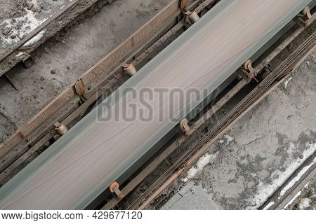 Empty Outdoors Conveyor Belt At Metallurgical Plant Area. Top View.
